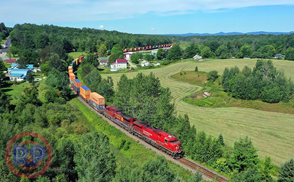 train pulling freight through countryside